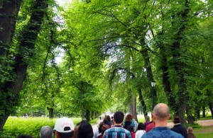 Group walking meditation entering Slottsparken